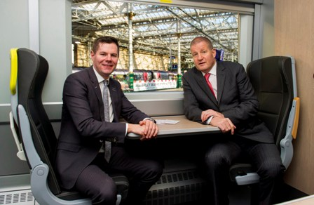10/02/16 - 16021003 - FIRST SCOTRAIL WAVERLEY SATION - EDINBURGH (L/R) Mr Derek Mackay, Transport Minister and Phil Verster, managing director of the ScotRail Alliance unveil the new electric train model at Waverley station