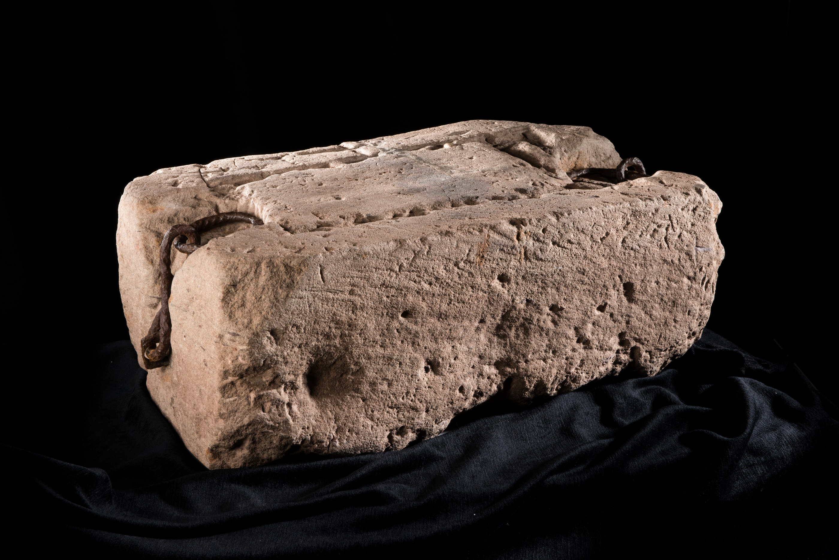 Stone of Destiny also known as the Stone of Scone, and often referred to in England as The Coronation Stone. Oblong block of red sandstone that was used for centuries in the coronation of the monarchs of Scotland, and later the monarchs of England and the Kingdom of Great Britain. Historically, the artefact was kept at the now ruined Scone Abbey in Scone, near Perth, Scotland. About 26 inches (660mm) by 16.75 inches (425mm) by 10.5 inches (270mm) and its weight approximately 336 pounds (152 kg). Currently kept and displayed in Edinburgh Castle, Edinburgh