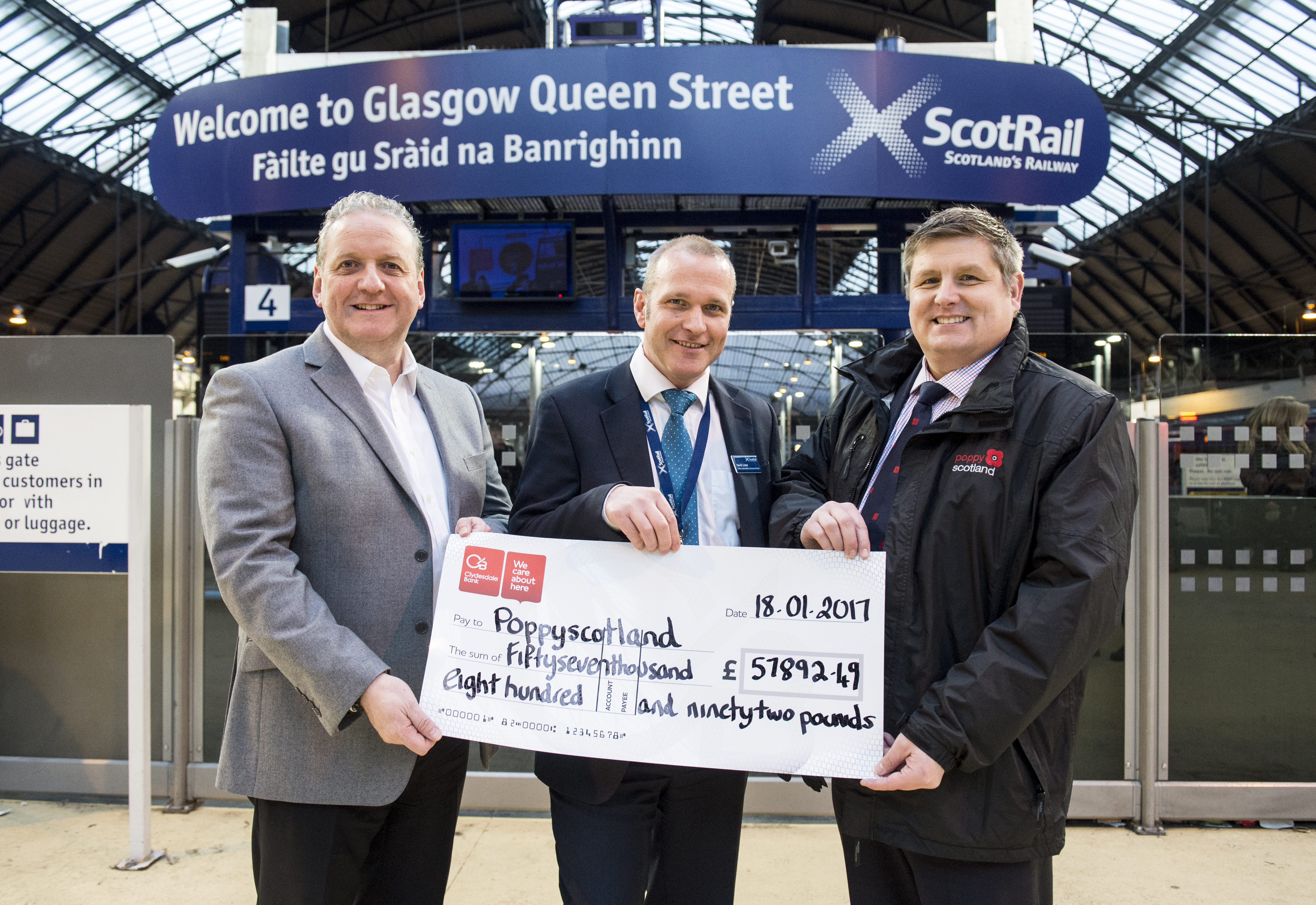 18/01/17 - FIRST SCOTRAIL - 17011805    QUEEN STREET STATION - GLASGOW     ScotRail Alliance sustainability & safety assurance director David Lister, along with station staff, will present a cheque to Poppyscotland for the total raised across the ScotRail Alliance network during last year's appeal.