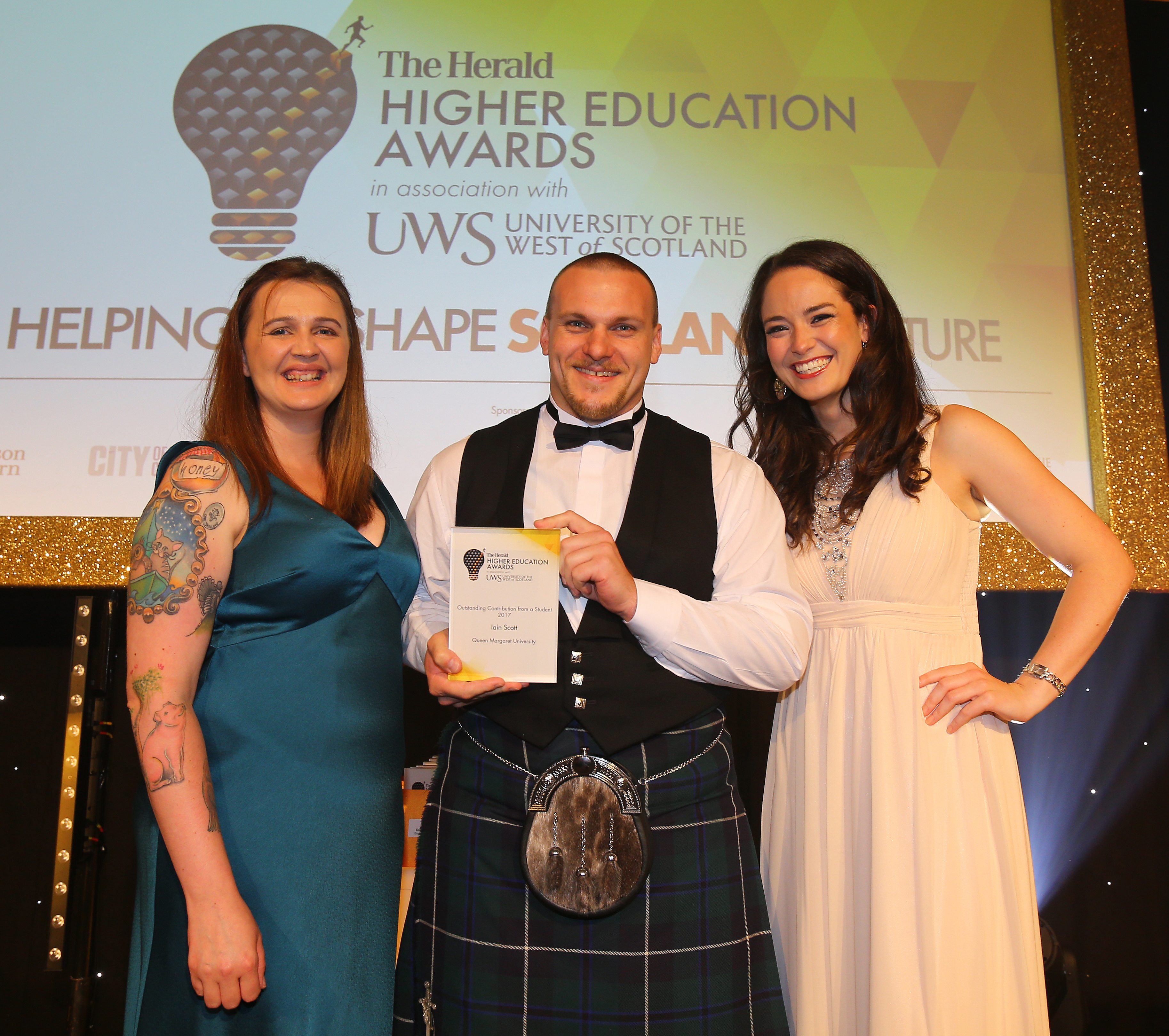 The Herald Higher Education Awards 2017. Radisson Blu hotel, Glasgow. Winner of Outstanding contribution from a student is Iain Scott of Queen Margaret University. Presenting the award is Vonnie Sandlan, NUS Scotland president, left and event host Jennifer Reoch at right. Photograph by Colin Mearns 6 July 2017