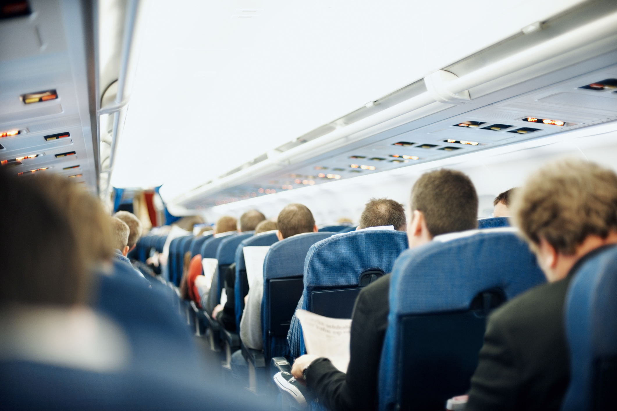 Aisle with group of passengers in an irplane