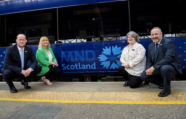 12/06/18 - 18061204 - SCOTRAIL  QUEEN STREET STATION - GLASGOW  L/R  Iain McWhirter (MND Head of Fundraising and Volunteering),  Morag McGowan (Corporate Partnership Manager), Sophie Nightingale (Scotrail Community Investment Officer) and Craig W F Stockton (MND Chief Executive)