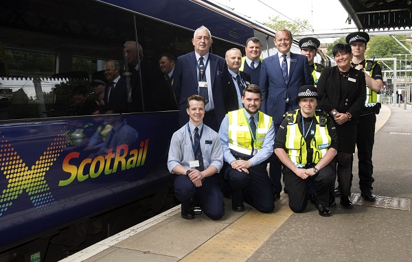 15/06/18 - 18061502 - SCOTRAIL EDINBURGH WAVERLY STATION - EDINBURGH Scotrail show their support for Pride Edinburgh by displaying their logo on the side of one of their trains Pictured - Back Row (L-R) David Sneddon, Bruce Blackie, John Marshall, Alex Hynes (Scotrail MD), Juliet Donnachie Front Row (L-R) Euan Forbes, Charles Hardy